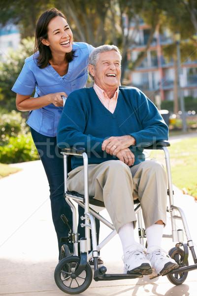 Carer Pushing Senior Man In Wheelchair Stock photo © monkey_business