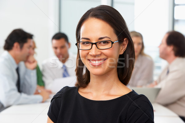 Portrait Of Businesswoman Sitting At Boardroom Table Stock photo © monkey_business