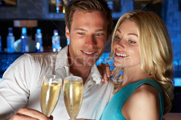 Couple Enjoying Glass Of Champagne In Bar Stock photo © monkey_business