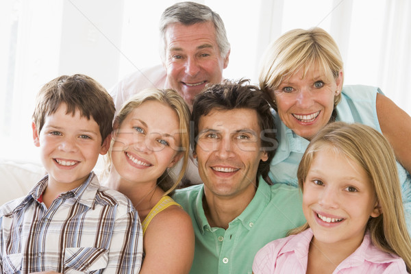 Family indoors together smiling Stock photo © monkey_business