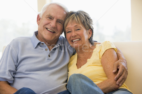 Couple relaxing in living room smiling Stock photo © monkey_business