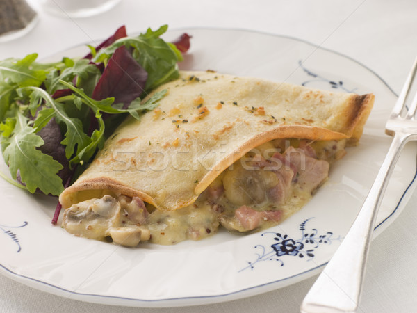 Savoury Pancake filled with Ham Cheese and Mushrooms with dresse Stock photo © monkey_business