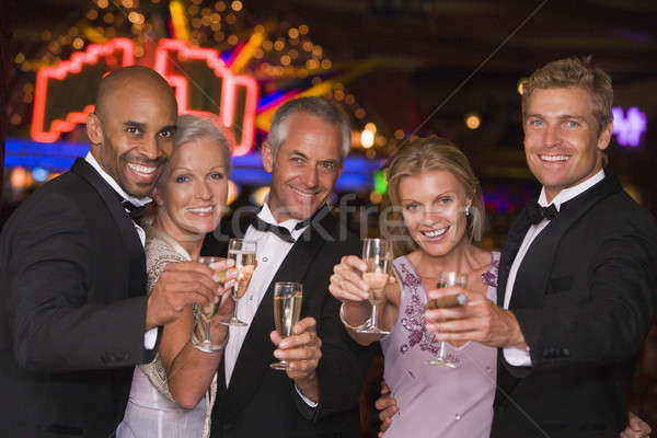 Group of friends celebrating win at casino Stock photo © monkey_business