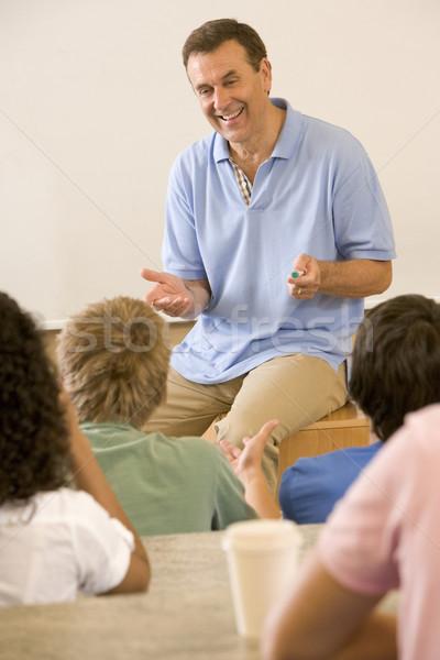 Kolegium nauczyciel wykład człowiek pióro edukacji Zdjęcia stock © monkey_business
