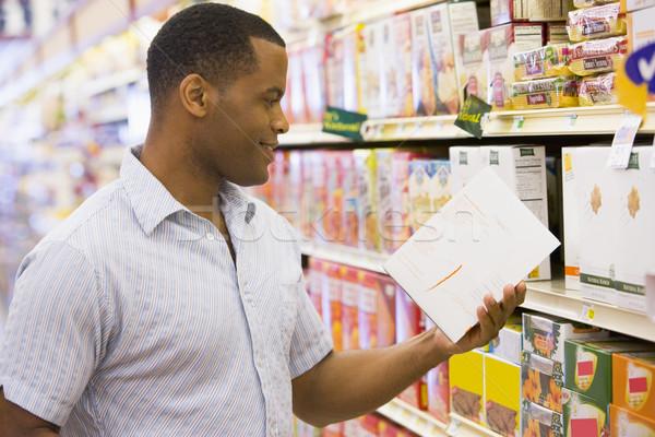 Man shopping in supermarket Stock photo © monkey_business
