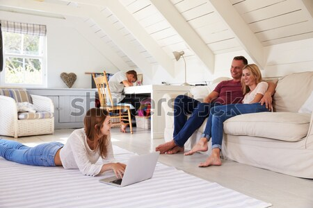 Man in living room watching television Stock photo © monkey_business