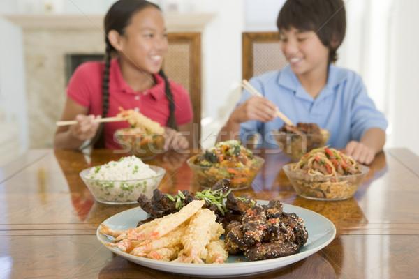 Kettő fiatal gyerekek eszik kínai étel ebédlő Stock fotó © monkey_business