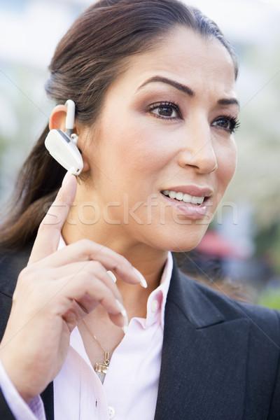 Femme d'affaires bluetooth technologie communication Homme personne Photo stock © monkey_business