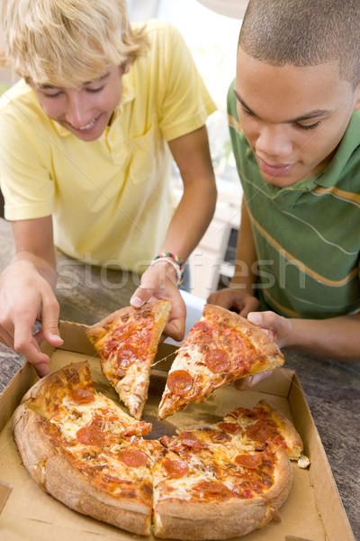 Ragazzi adolescenti mangiare pizza felice amici formaggio Foto d'archivio © monkey_business