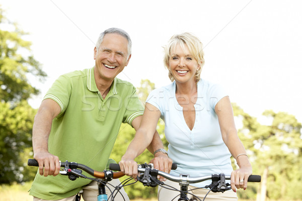 Сток-фото: зрелый · пару · верховая · езда · велосипедах · женщину · человека