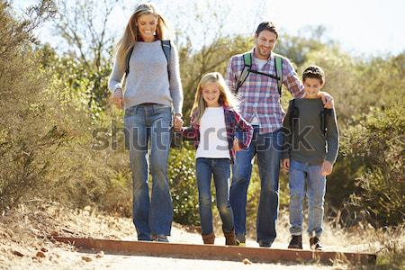 Family Group Standing Outdoors On Wooden Walkway In Autumn Lands Stock photo © monkey_business