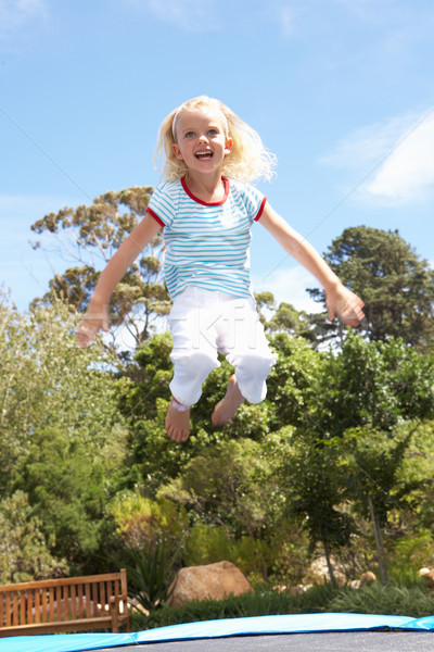 Young Girl Jumping On Trampoline In Garden Stock photo © monkey_business