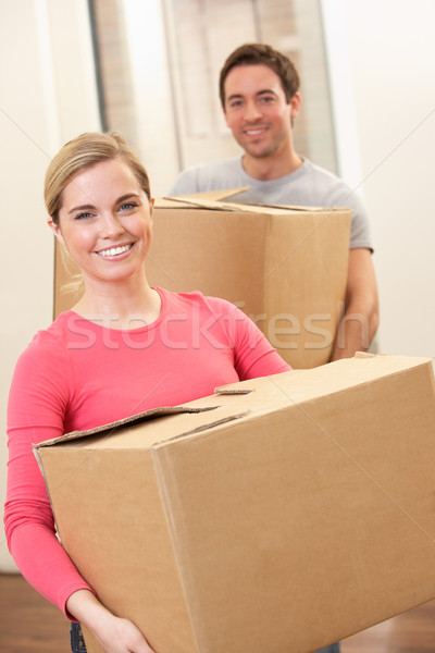 Young couple on moving day carrying cardboard boxes Stock photo © monkey_business