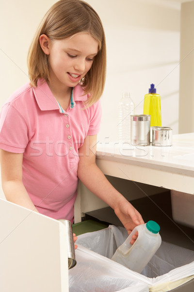 Young Girl Recyling Waste At Home Stock photo © monkey_business