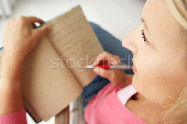 Senior woman writing in notebook Stock photo © monkey_business