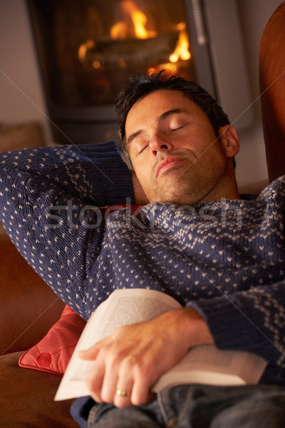 Middle Aged Man Asleep With Book By Cosy Log Fire Stock photo © monkey_business