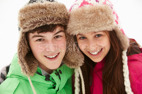 Portrait Of Teenage Couple In Snow Wearing Fur Hats Stock photo © monkey_business