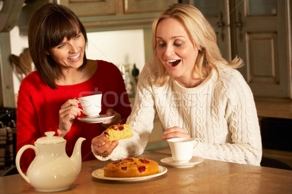 Dois mulheres chá bolo Foto stock © monkey_business