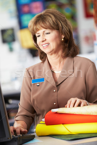 Stock photo: Female Cashier At Clothing Store