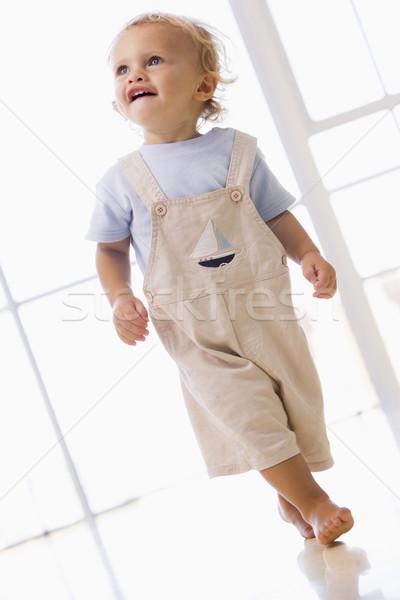 Fiatal srác sétál bent mosolyog gyermek fiú Stock fotó © monkey_business