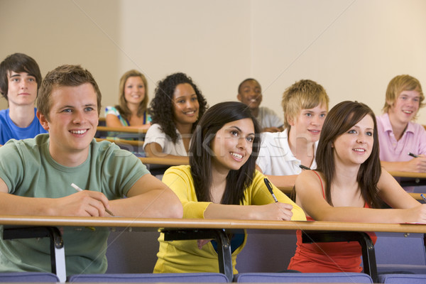College students listening to a university lecture Stock photo © monkey_business
