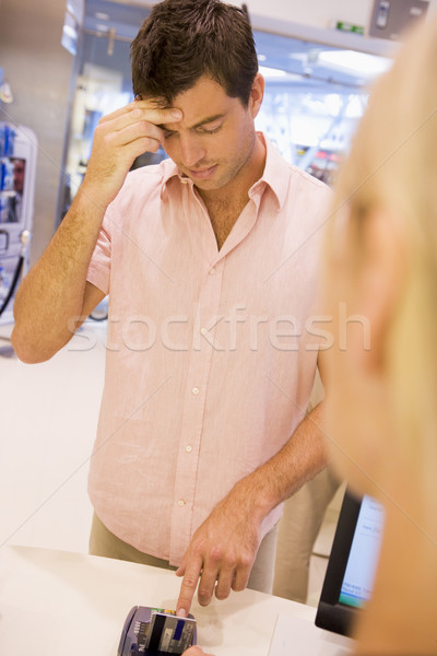 Man trying to remember card PIN number Stock photo © monkey_business