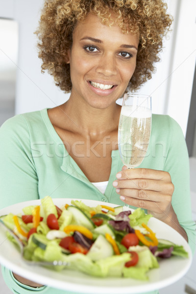 Mid Adult Woman Holding A Wine Glass And Fresh Salad Stock photo © monkey_business
