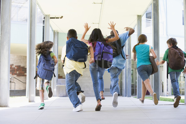 Elementary school pupils running outside Stock photo © monkey_business