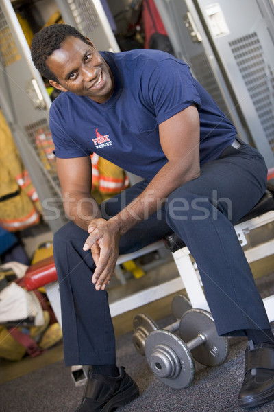 Portrait of a firefighter in the fire station locker room Stock photo © monkey_business