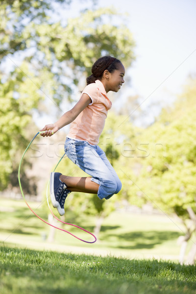 Stockfoto: Jong · meisje · touw · buitenshuis · glimlachend · meisje · kinderen