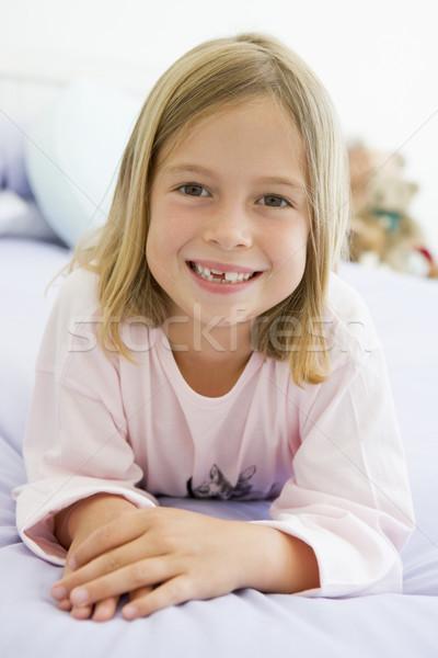 Giovane ragazza letto pigiama ragazza bambini felice Foto d'archivio © monkey_business