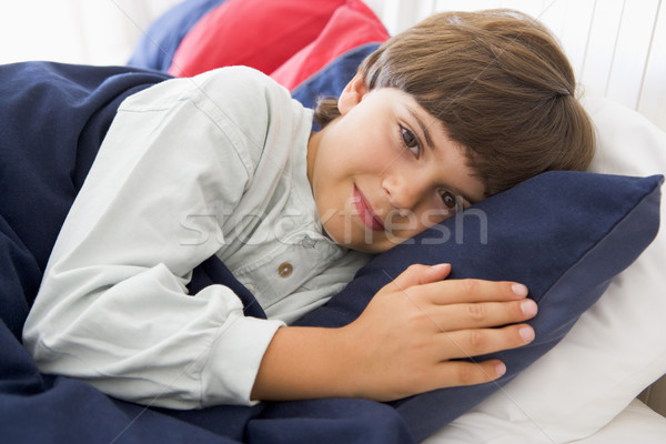 Young Boy Lying Down In His Bed Stock photo © monkey_business