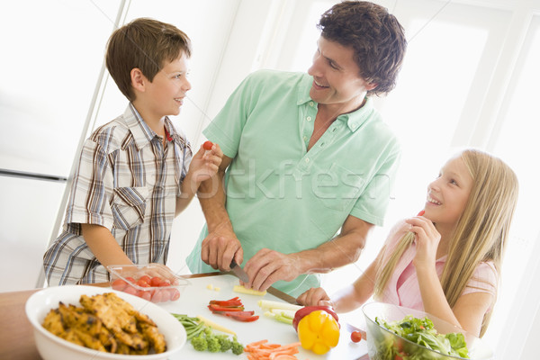 Stock photo: Father And Children Prepare A meal,mealtime Together