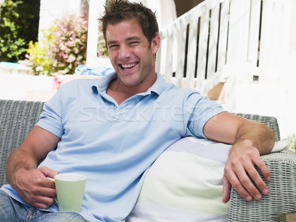 человека сидят патио кофе смеясь Председатель Сток-фото © monkey_business