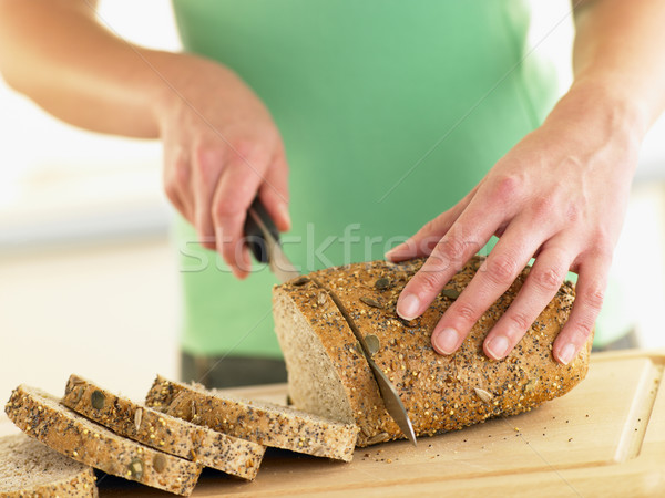 Woman Slicing Mixed Grain Bread Stock photo © monkey_business