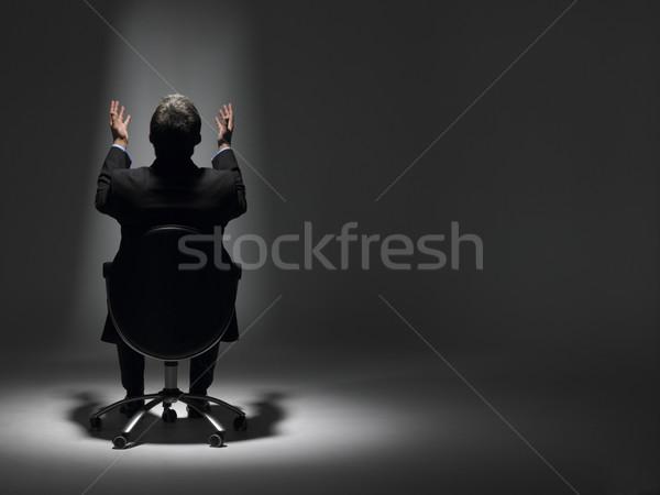 Zdjęcia stock: Biznesmen · posiedzenia · Spotlight · biuro · człowiek · świetle