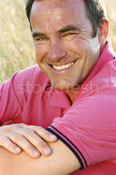Man sitting outdoors smiling Stock photo © monkey_business