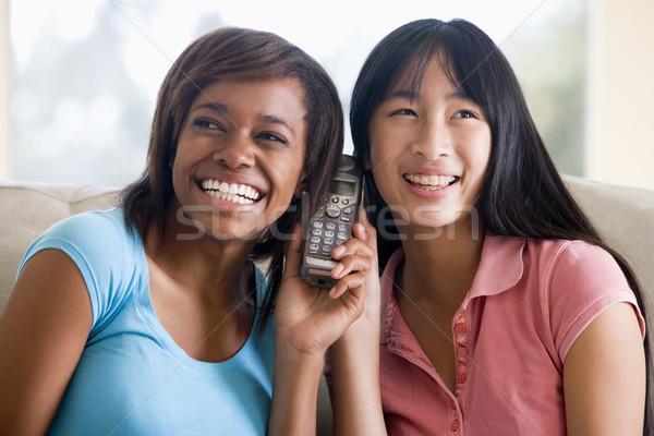 Falante telefone feliz amigos adolescente Foto stock © monkey_business