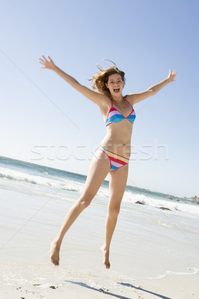 Donna spiaggia indossare bikini Ocean sabbia Foto d'archivio © monkey_business
