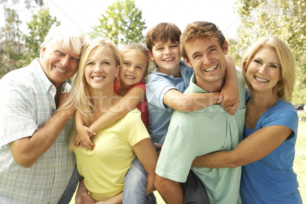 Mother And Father Giving Children Piggy Back With Grandparents Stock photo © monkey_business