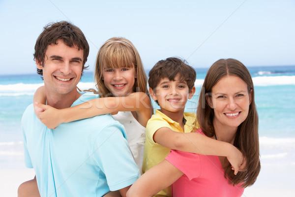 Família piggyback diversão férias na praia praia feliz Foto stock © monkey_business