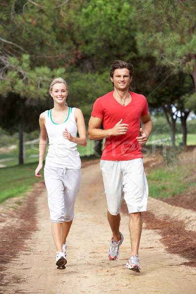 Corrida parque mulher feliz fitness Foto stock © monkey_business