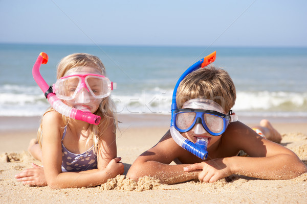 Young children on beach holiday Stock photo © monkey_business