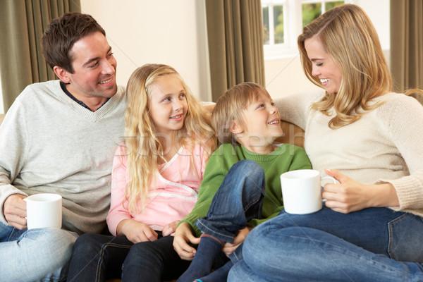 Boldog fiatal család ül beszél kanapé Stock fotó © monkey_business