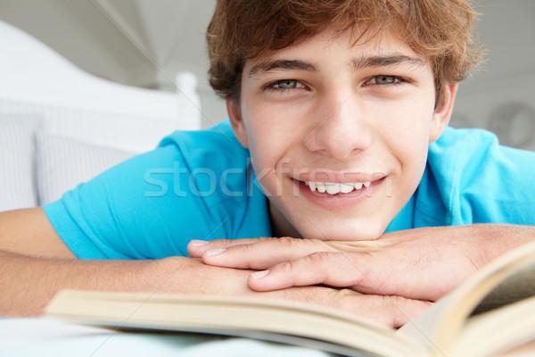 Teenage boy reading a book Stock photo © monkey_business