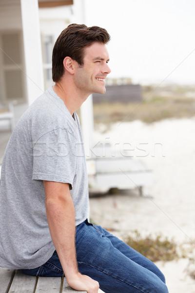 портрет человека сидят улице пляж солнце Сток-фото © monkey_business