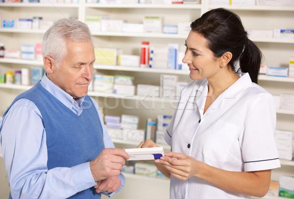 American pharmacist serving  senior man in pharmacy Stock photo © monkey_business