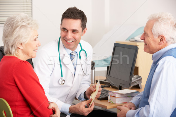 American doctor talking to senior couple in surgery Stock photo © monkey_business
