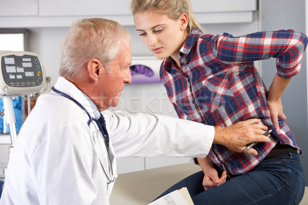 Teenage Girl Visits Doctor's Office With Back Pain Stock photo © monkey_business