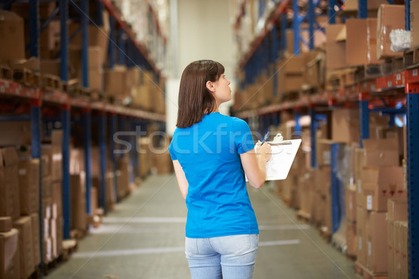 Rear View Of Female Worker In Distribution Warehouse Stock photo © monkey_business